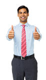 Confident Young Businessman Gesturing Thumbs Up Royalty Free Stock Photo