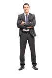 Confident young businessman in a gray suit Royalty Free Stock Photos