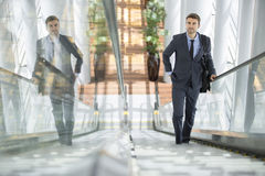 Confident Successful Young Businessman Walking Up The Stairs To A Meeting Royalty Free Stock Images