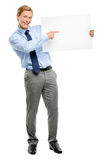 Confident young businessman holding banner isolated  on white ba Stock Photo