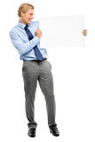 Confident young businessman holding banner isolated  on white ba Royalty Free Stock Photography
