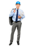 Confident young businessman holding blueprints on white backgrou Stock Photos