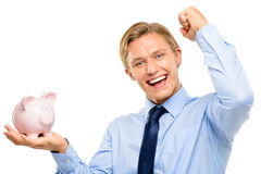 Confident young businessman holding piggybank is successful isol Royalty Free Stock Photography