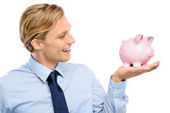 Confident young businessman holding piggybank is successful isol Royalty Free Stock Images