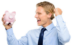 Confident young businessman holding piggybank is successful isol Stock Photo