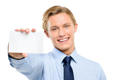 Confident young businessman holding placard isolated  on white b Stock Image