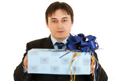 Confident young businessman holding present Stock Image