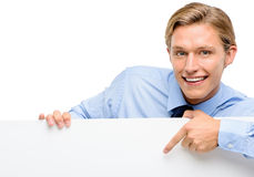 Confident young businessman looking over banner isolated  on whi Royalty Free Stock Photography