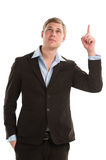 Confident young businessman pointing upwards isolated. Confident young businessman pointing upwards while isolated on a white background royalty free stock photography