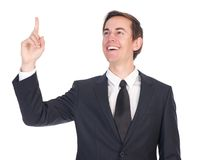 Confident young businessman smiling and pointing finger Royalty Free Stock Photo