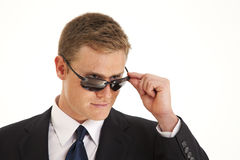 Confident young businessman with sunglasses. Portrait of confident young businessman wearing a suit and sunglasses Stock Image