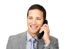 Confident young businessman talking on phone. Against a white background Stock Images