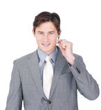 Confident young businessman using headset Royalty Free Stock Photography