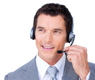 Confident young businessman using headset Stock Images