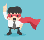 Confident young businessman wearing a drawn cape and mask Stock Photos