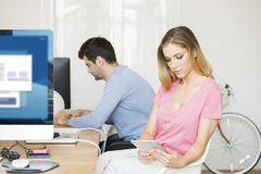 Confident young businesswoman with digital tablet Royalty Free Stock Photos