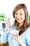 Confident young businesswoman drinking coffee Royalty Free Stock Images