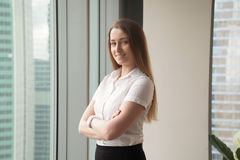 Confident young businesswoman enjoys success stock photography