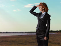 Confident young businesswoman  horizon Royalty Free Stock Photos