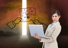 Confident young businesswoman with laptop. Composite image of confident young businesswoman with laptop Royalty Free Stock Images