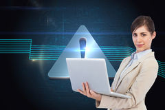 Confident young businesswoman with laptop. Composite image of confident young businesswoman with laptop Royalty Free Stock Image