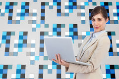 Confident young businesswoman with laptop Royalty Free Stock Images