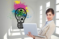 Confident young businesswoman with laptop. Composite image of confident young businesswoman with laptop Stock Images