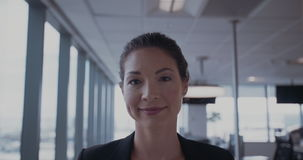 Confident young businesswoman in office stock footage
