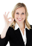 Confident young  businesswoman showing OK sign Royalty Free Stock Photo