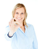 Confident young businesswoman showing OK sign Stock Photos