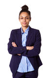 Confident young businesswoman standing on white background Stock Images