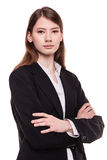 Confident young businesswoman / student arms crossed in Studio Stock Photography