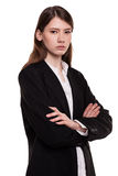 Confident young businesswoman / student arms crossed in Studio Stock Image