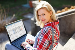 Confident young businesswoman working on laptop Stock Images