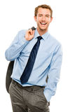 Confident young bussinessman holding suit jacket smiling white b Stock Photos