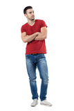 Confident young casual style man with crossed arms looking away. Full body length portrait isolated over white studio background royalty free stock photos