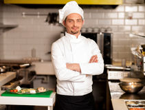 Confident young chef posing Stock Photos