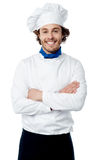 Confident young cook posing in uniform Royalty Free Stock Photos