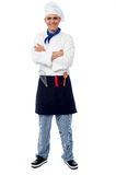 Confident young cook posing in uniform Royalty Free Stock Photography