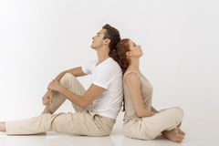 Yound couple indoors in studio. Stock Image