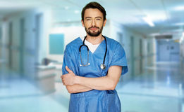 Confident young doctor in a hospital foyer Royalty Free Stock Photo