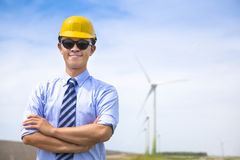Confident  young engineer standing with wind generator Stock Image