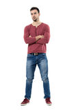 Confident young fashion male model with folded hands looking at camera. Royalty Free Stock Photography