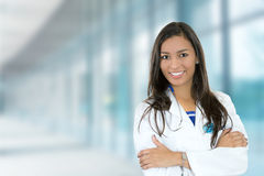 Confident young female doctor medical professional in hospital. Portrait confident young female doctor medical professional standing  on hospital clinic hallway Stock Photo