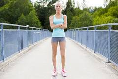 Confident young female runner having break after workout Stock Photo