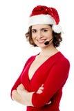 Confident young female santa Stock Photos