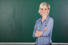 Confident Young Female Teacher In Front Of Chalkboard Stock Photos