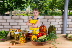 Confident young girl with her preserved vegetables Royalty Free Stock Photos