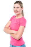 Confident young girl posing, arms crossed Royalty Free Stock Photos