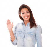Confident young lady with greeting hand. Portrait of confident young lady on blue blouse with greeting hand smiling at you on isolated studio Royalty Free Stock Image